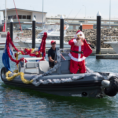 Super soakers and Santa thrill children at R Marine South Australia Christmas party