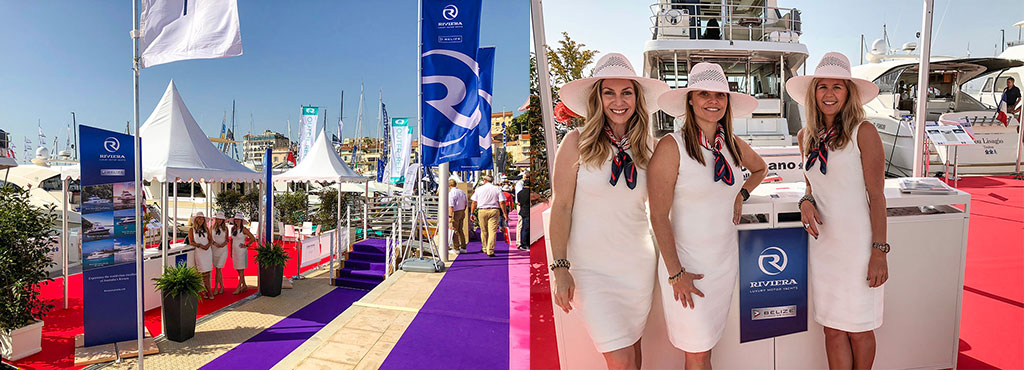 Left: Riviera flags fly proudly as our team prepares to welcome visitors to our showcase at the Cannes Yachting Festival. Right: Welcoming visitors to our two-model showcase at the Cannes Yachting Festival.