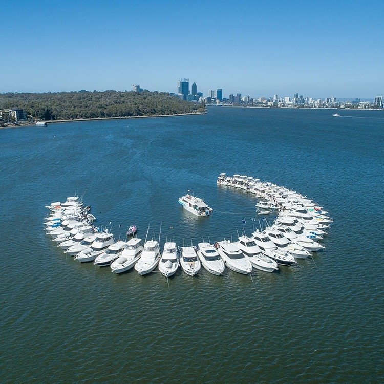 Wedding vows and bright sunshine for giant R Marine Perth Christmas Swan River raft-up