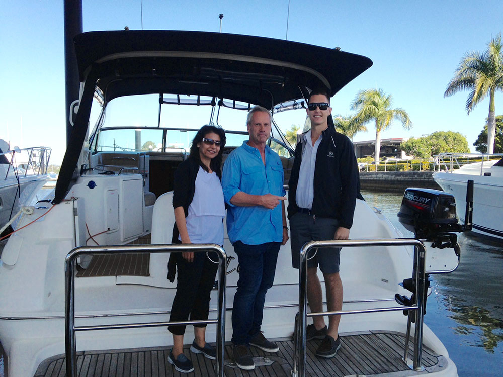 Paul and Adele accept the keys of their Riviera M370.