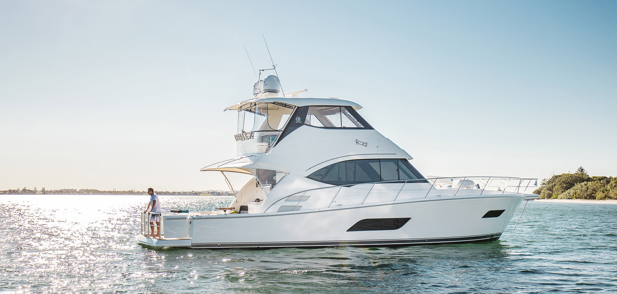 Riviera to Premiere blue water 52 Enclosed Flybridge in four-model display at Caribbean International Boat Show