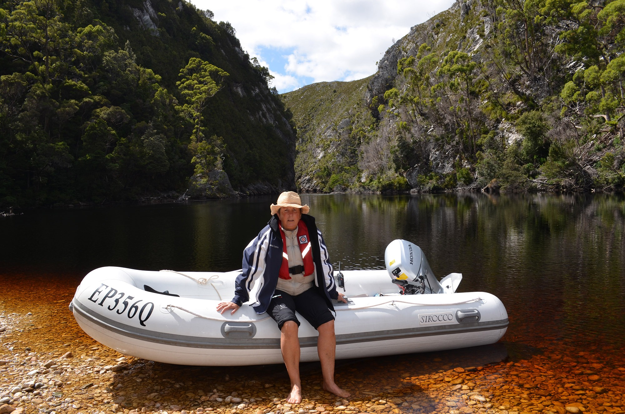 Taking Pascua Lama's tender into a Tasmanian river gorge.