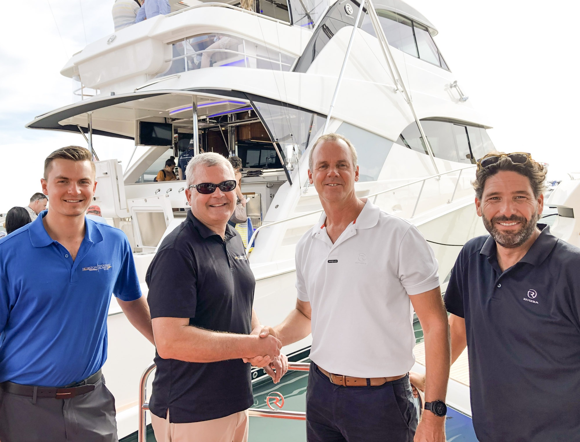 Grahame Chavoustie and Michael Chavoustie from Horizon Marina with Riviera Chairman Rodney Longhurst and Riviera International Sales Director, Chris McCafferty.