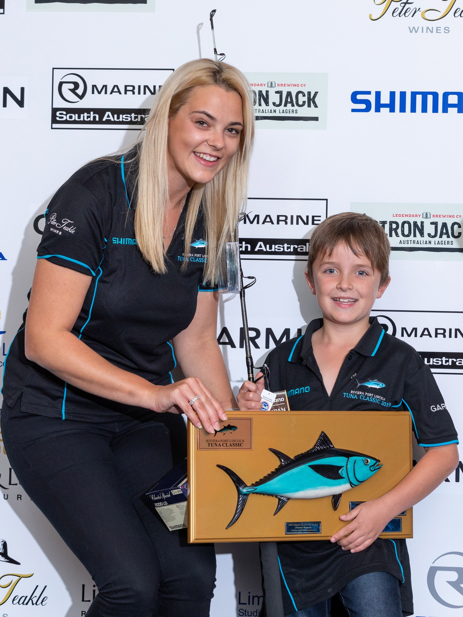 Champion smallfry angler, Harry Czabayski with Gabriella Gabbana.