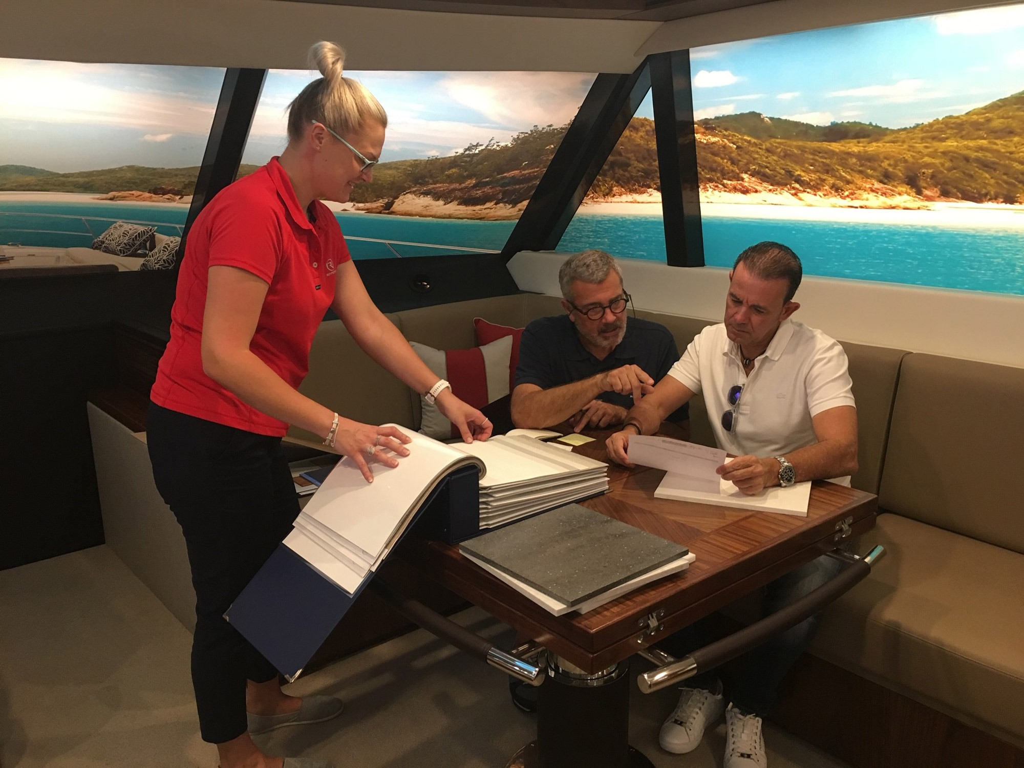 Jose Manual Anton (right) inspects interior colour samples with Riviera's Europe Sales Manager Jan Van Oostenryck at Riviera's Experience Centre.