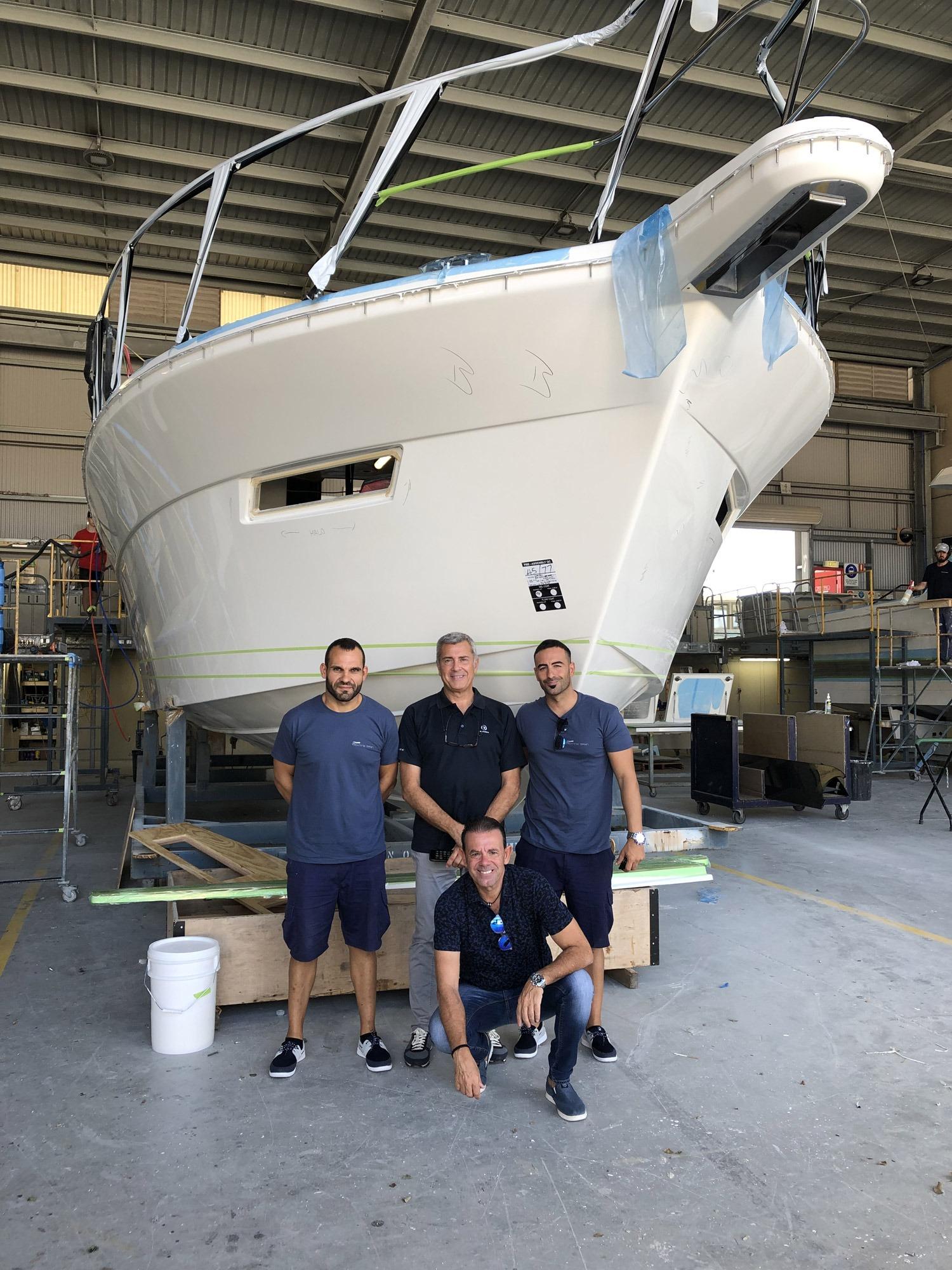 The Yachting Spain team at the Riviera facility. Front: Jose Manual Anton. Behind, from left: service representative Sergio Anton Garcia, Riviera's Jan Van Oostenryck, service representative Nicolas Cuevas
