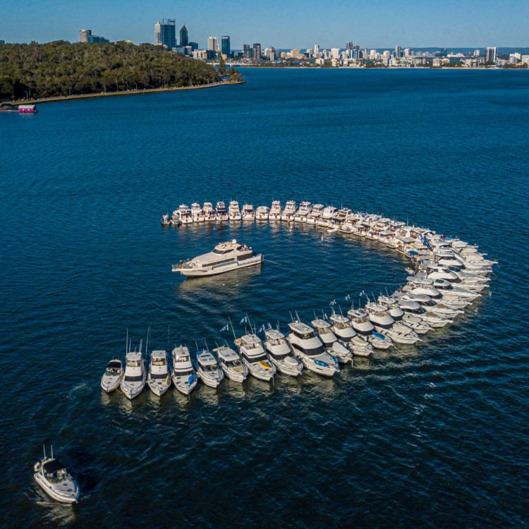 The Riviera Family in Perth celebrate as 45 motor yachts raft-up on the Swan River